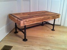 Industrial wood & steel coffee table, reclaimed barnwood with industrial pipe legs. Love the industrial look!