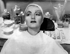 """An Eyebrow is Born: Max Factor testing eyebrows — and the """"Crawford Smear"""" on the lips — on Janet Gaynor in 1937′s A Star is Born. Funny scene"""