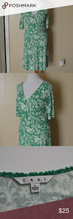 "CAbi 572 Faux Wrap Jersey Dress For your consideration is a CAbi green and white floral dress in size large.  Faux wrap style.  3/4 sleeve.  V-neck.  Jersey material.   Excellent condition!  Style: 572  94% rayon 6% spandex  Measurements laying flat: Shoulders (top shoulder seam to top shoulder seam): 16.25"" Bust (armpit to armpit): 19"" Waist: 15.5"" Hips: approx 22.5"" Sleeve length (armpit to cuff): 7.5"" Total length (top of shoulder to bottom hem): 38"" CAbi Dresses"