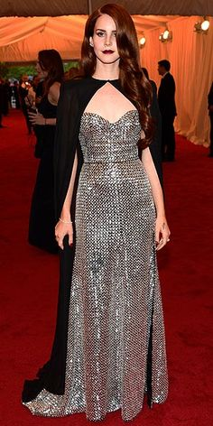 """LANA DEL REY    """"We wanted to do something that would be a little dark and glamorous,"""" designer Joseph Altuzarra says of the sparkling silver bustier gown he whipped up for the singer, which she accents with a showstopping cape."""