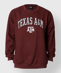 """This item is part of the 2014 Official Sideline Collection from Adidas. This oversized warm fleece crew neck sweatshirt has tackle twill appliqués on the front that read """"Texas A&M"""". There is also an embroidered block ATM. 55% Cotton, 45% Polyester."""
