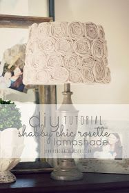 DIY:  How to Make a Shabby Chic Rosette Lamp Shade - this tutorial has clear pictures showing how to make rosettes using fabric and hot glue - via Jennifer Ciani