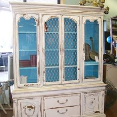 A fantastic china hutch with a very shabby chic facelift