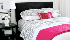 What a great way to use patterned sheets with white bedding...the pink pillow and coverlet add a punch of colour. Nice for a spring/summer look.