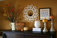 Top of piano decor for fall, love the mirror and the owl!  Her whole home is so comfortable and pretty!
