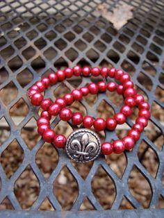 Pink Fresh Water Pearl Fleur De Lis bracelets by nmoffit on Etsy, $12.00--made by girl in Wichita!