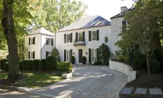 LIME-AND POWER-WASHED EXTERIOR HELPED AGE THE EARLY 1970'S CONSTRUCTION  Darryl Carter