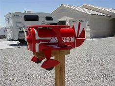 Red Bi-Plane Mailbox. >>>>Arizona's best AVIATION THEMED RESTAURANT! Tell your friends we'd love to see them visit us at the LEFT SEAT WEST RESTAURANT, Glendale, Arizona!  Check out our Facebook page! http://www.facebook.com/pages/Left-Seat-West-Restaurant/192309664138462
