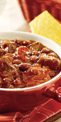Tender beef and chili beans in a mouthwatering tomato sauce prepared in  your slowcooker.