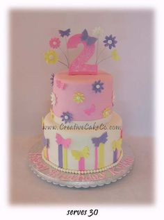 2 tier butterflies and flowers birthday cake by Creative Cake Co.