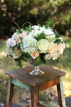 Low centerpiece with curly willow, white hydrangea, Mondial roses, Quicksand roses, Sahara roses, Chablis spray roses, White Majolica spray ...