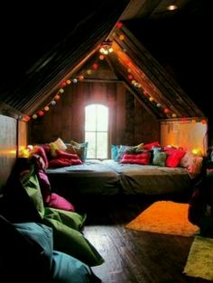 personal gypsy den- i want an attic to do this in... 2 beds pushed together to make one big bed, jewel colored bedding and pillows, lantern lights or white christmas lights, floor cushions for seating, hang 2 tapestries to cover window