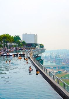 At the Marina Bay Sands hotel the guests can relax at the largest rooftop infinity pool in the world with breathtaking views of the city all around.