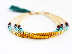 Multicolor Beaded Friendship Bracelet with Tassel - Cream Chocolate Butterscotch Yellow Turquoise Gold Peacock Green - Southwestern Jewelry Friendship Bracelets With Beads, Seed Bead Bracelets, Seed Bead Jewelry, Sea Glass Jewelry, Silver Bracelets, Seed Beads, Turquoise Beads, Turquoise Bracelet, Yellow Turquoise