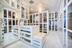 The most amazing, show stopping white walk in closet / wardrobe with glass doors, drawers, padded ottoman. I think I've died and gone to heaven!!!
