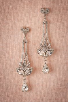 Eli Chandeliers in Shoes & Accessories Jewelry Earrings at BHLDN Debra Moreland, the inimitable designer behind our delicate veils, work-of-art jewelry and hairpieces (including the most beautiful halos and ornaments!), painstakingly creates each accessory by hand in her Cincinnati studio with a select group of skilled artisans. We love the chic, architectural elements of this handset crystal pendant pair.