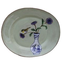 An original ceramic work by Lisa Ringwood entitled: 'White-eye and Wild Scabiosa flowers (green oval platter)', ceramic, d 38cm.