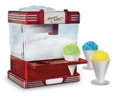 Make your favorite summertime treat year-round from the comfort of your own home with the Nostalgia Electrics Snow Cone Maker This retro-styled snow cone machine has the ability to create fruity slush drinks, yogurt snow, and smoothies. Cool Kitchen Gadgets, Cool Gadgets, Kitchen Tools, Cool Kitchens, Kitchen Appliances, Kitchen Dining, Amazon Gadgets, Latest Gadgets, Travel Gadgets