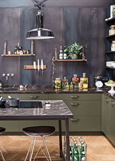 the loft - industrial chic kitchen with black marble, olive cabinetry and open shelving   via coco+kelley                                                                                                                                                                                 More