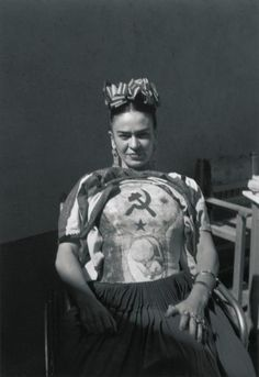 ~ Frida Kahlo, 1941, displays her Communist sympathies with her therapeutic plaster chest cast.