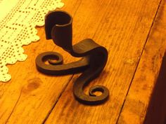 Candle holder, blacksmith forged. by SouthSaxonForge on Etsy https://www.etsy.com/listing/169404247/candle-holder-blacksmith-forged