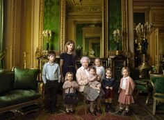 This official photograph, released by Buckingham Palace on Wednesday April 20, 2016,  to mark her 90th birthday, shows Queen Elizabeth II with her five great-grandchildren and her two youngest grandchildren in the Green Drawing Room, part of Windsor Castle's semi-state apartments in Windsor, England. The children are: James Viscount Severn, 8, left, and Lady Louise, 12, second left, the children of The Earl and Countess of Wessex; Mia Tindall, holding The Queen's handbag, the two-year-old…