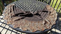 This shawl is a little less daunting that Grandifolia. It starts with a Crescent with Leaf accents. The border is worked in the Grandifolio leaves pattern, but with just three leaves per branch.