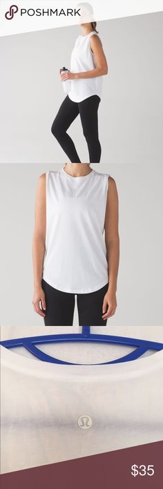 Lululemon Brunswick Muscle Tank White Yoga tank with Cotton and lyrcra. Loose and comfy. No size tag but measurements are: 24.5 collar to bottom and 19.5 armpit to armpit. Muscle tee/top. Listed as 8  but could be worn oversized by most people and can fit up to XL lululemon athletica Tops Tank Tops