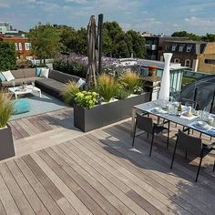Bermondsey roof terrace Southwark in South London, The roof terrace belongs to the penthouse apartment and the brief was to create a contemporary roof terrace d