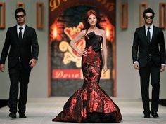 Anna Chapman, the Russian ex-spy deported from the US, walked in a Turkish fashion show with two men dressed as secret agents (via today.com)
