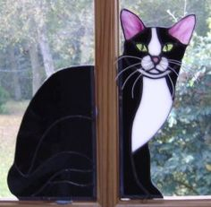 What is UNUSUAL about this Cat? It is actually TWO PIECES - one on each side of the window frame... Clever!