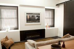 Living Room with Escea fireplace and sliding Macassar Ebony veneer door. Brooke Aitken Design.
