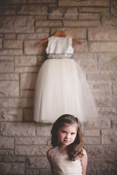 Flower girl in front of her dress. #too cute.