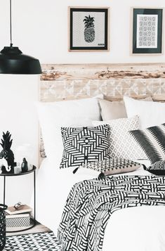 Bedroom - white bedding  woth graphic accents and reclaimed wood