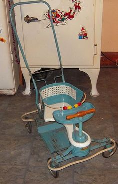 """Taylor Tot stroller/walker...my brother rode in one and my mom called it the """"gig""""!  I loved mine! vroom-vroom."""
