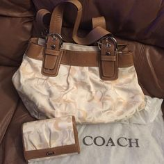 """Coach bag & wallet ‼️Authentic Latte & Cream Coach signature collection with the Coach """"C"""" on the bag with brown leather trim and handle. With a matching wallet. Water repel fabric. It also ones with the Coach fit bag. The dust bag string is a little unraveled but dust bag is still able to close. Coach Bags Hobos"""