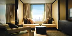 Banyan Tree Bangkok Hotel: The living room of each One-Bedroom Suite has wall-to-wall windows for taking in city views.