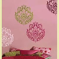 Wall Stencils (not wallpaper) allow you to be even more expressive and custom. There are many possibillities at http://www.cuttingedgestencils.com