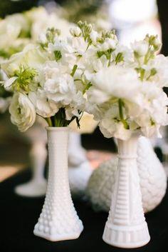 Milk Glass Centerpieces 275x412 Black and White Runway Inspired Wedding Details