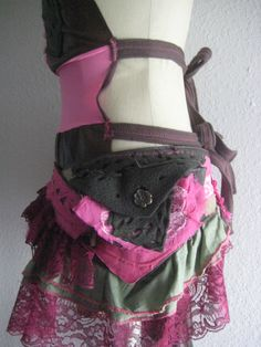 Pretty in Pink Urban Pixie/Steampunk Utility Belt with Bustle Skirt Pocket Tattered Pink and Army Green with Green and Magenta Lace Trim. $64.00, via Etsy.