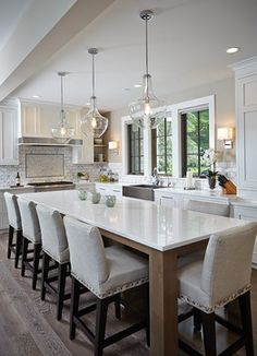Villa Decor - Reeds Lake Home - Kitchen - great counter height island, pendants, cabinets, backsplash, flooring Dining Table In Kitchen, Home Decor Kitchen, Kitchen Interior, New Kitchen, Interior Design Living Room, Kitchen Design, Kitchen Ideas, Updated Kitchen, Luxury Kitchens