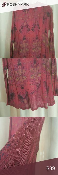 Free people top This is so adorable. Short in front, long in back. From the shoulder down to cuff on sleeve, it has lace. See thru. Really cute. Free People Tops Blouses
