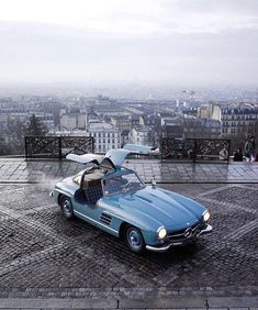 """Class Golden Era on Instagram: """"Paris says bonjour, so does the car. ⠀⠀ A Mercedes 300 SL Gullwing in its iconic Hellblau colorway and a panoramic view of Paris from…"""" Maserati 3200 Gt, Maserati Merak, Mercedes Benz 300 Sl, Mercedes 300sl, Mercedes Classic, Bmw Classic Cars, Mercedez Benz, Car Photography, Sport Cars"""