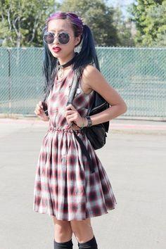 Grunge girl wearing cool plaid dress