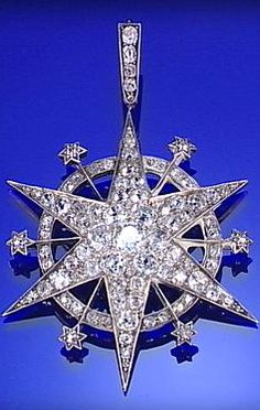 DIAMOND STAR PENDANT, CIRCA 1890, THE TWELVE RAYS INTERSECTED BY A CIRCLE.