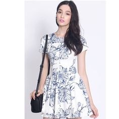 An abstract print adds delicate romance to a fit-and-flare frock. Subtle pleats lend volume to the skirt, flattering the figure. Put your hair up in a feminine  - $30 Abstract Print, Up Hairstyles, Frocks, Fit And Flare, Your Hair, Delicate, White Dress, Short Sleeve Dresses, Romance