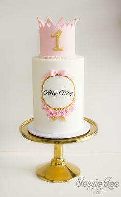Jessie lee cakes. Pink and gold first birthday cake. Design credit to Rosy cakes NZ.