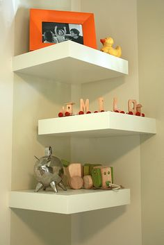 hung three of these in one of the corner's of H's room. perfect for stuffed animals and piggy banks!