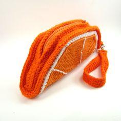 He encontrado este interesante anuncio de Etsy en https://www.etsy.com/es/listing/221787605/orange-slice-clutch-purse-foodie-wrist
