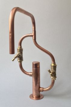 It's made of 15x1mm copper pipe and bronze fittings perfectly welded and sealed. The stop valves are high quality forged brass. #copper #pipe #steampunk #industrial #deckmount #wallmount #bronze #handmade #faucet #tap #robinet #scandinavian #brutalist #kitchen #bathroom
